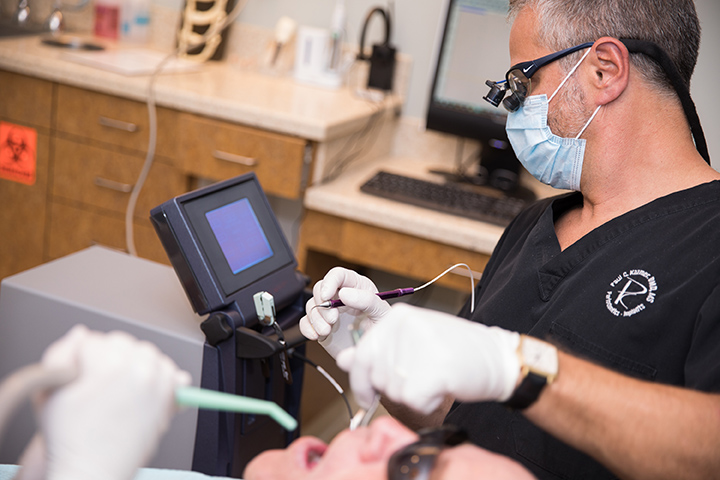Dr Paul Kazmer treating a patient with laser dentistry Cary, NC